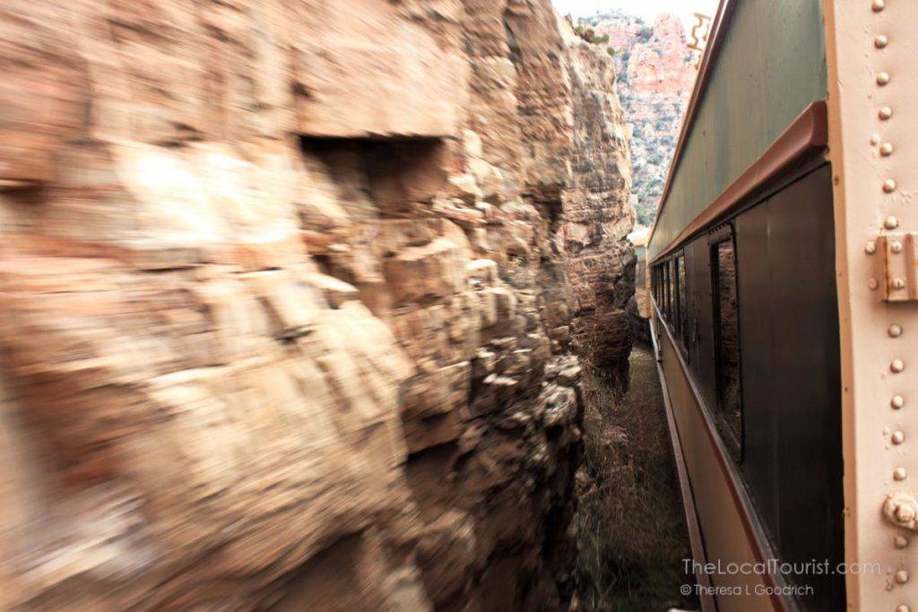 Verde Canyon Excursion Railroad exiting the tunnel in the mountain