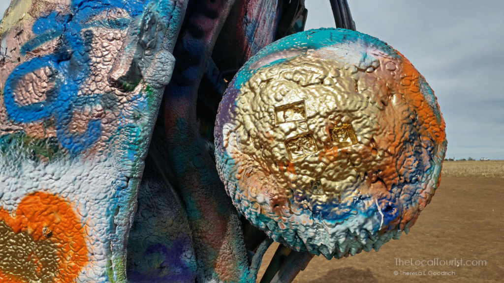 Layers of paint on a tire at Cadillac Ranch