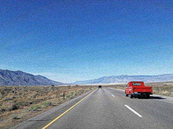 Red truck on an open road