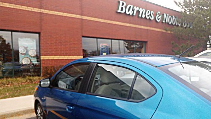 Barry the Mitsubishi Mirage outside Barnes & Noble
