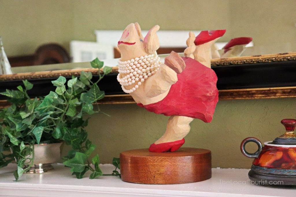 Dancing pig on the mantel