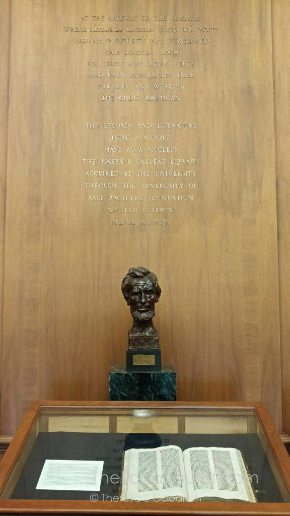 Bust of Abraham Lincoln at Lilly Library with a Gutenberg Bible