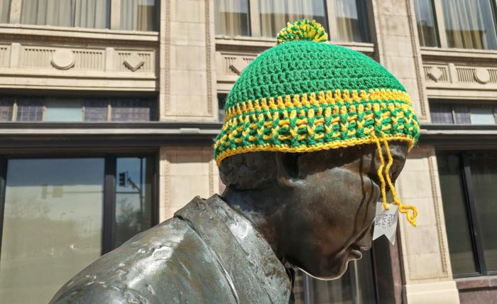 Public art in downtown Wichita - statue with knit hat that's free for anyone who needs it