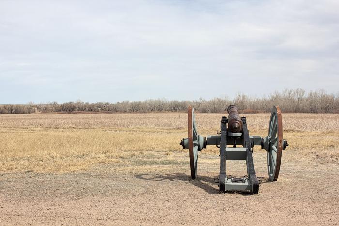 Cannon aimed over the Arkansas River