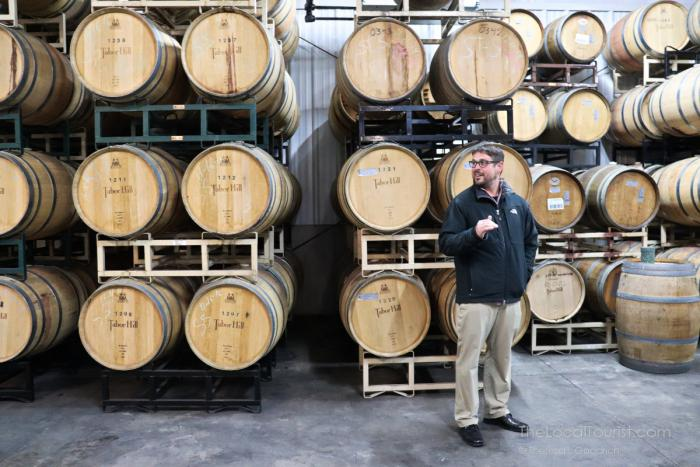 Matt Moersch sharing his passion for wines at Table Hill Winery's barrel room