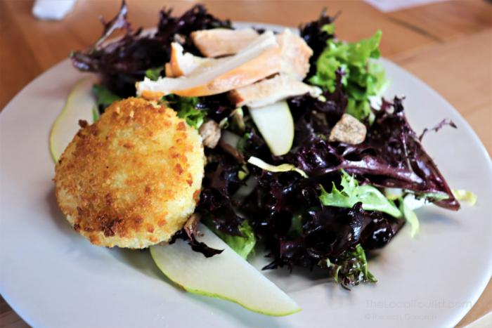 Round Barn Brewery & Public House Salad made with local goat cheese from Fennville, smoked pheasant, fresh pears, and champagne vinaigrette.